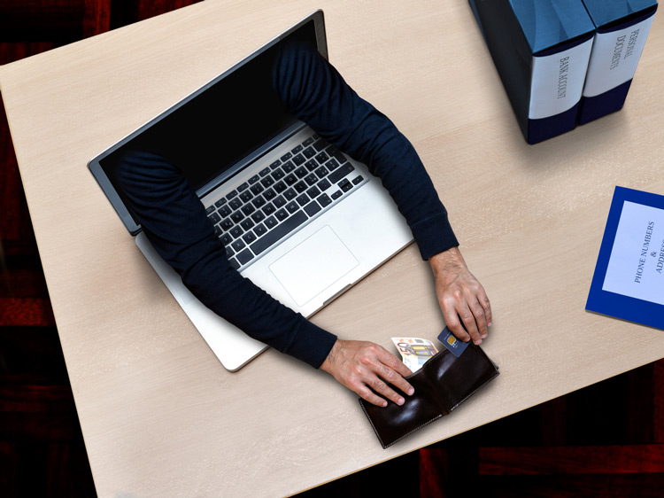 hacker stealing credit cards datas , money and password from laptop in office